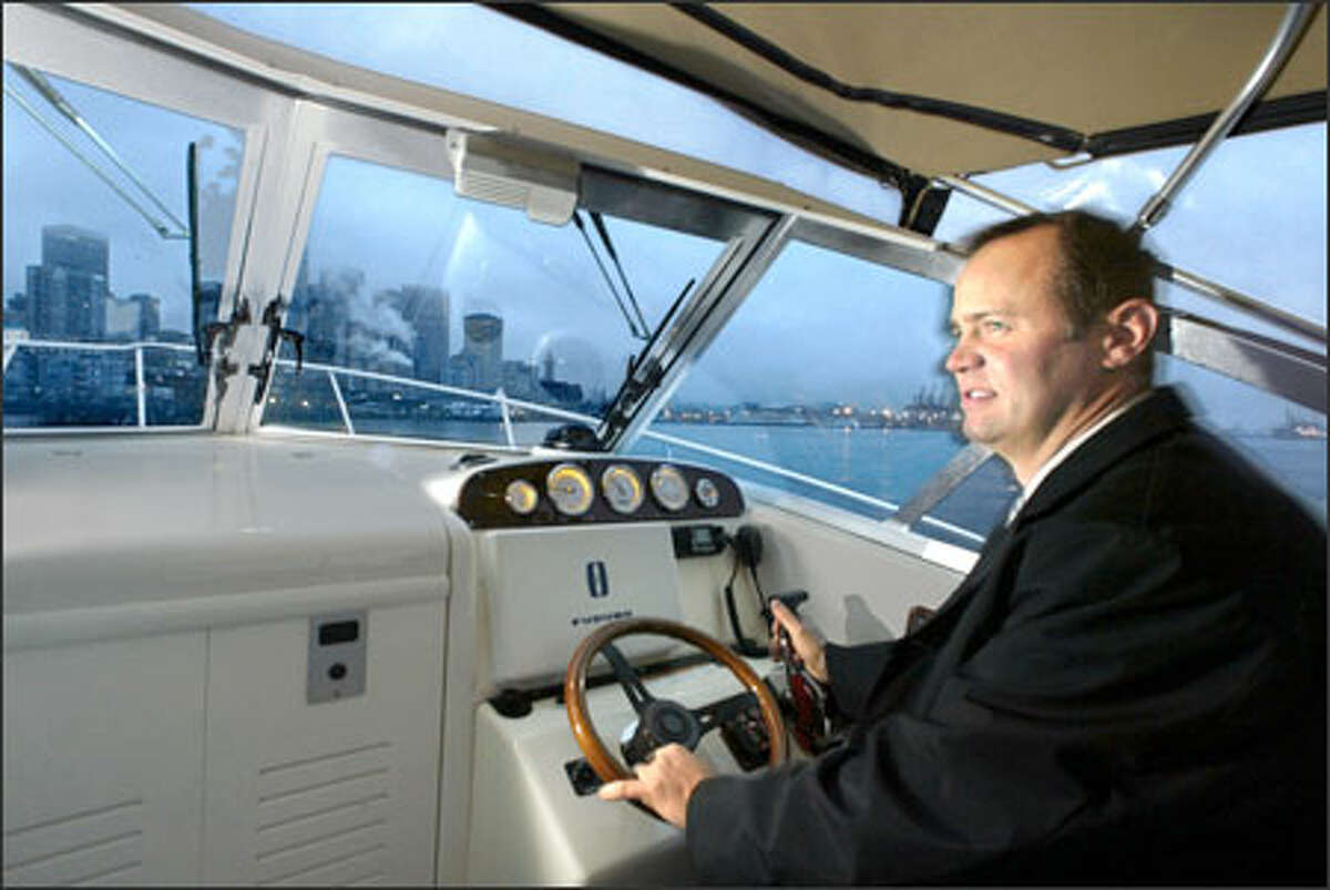 Parker Ferguson, en route from his Bainbridge Island home, points his powerboat toward Bell Harbor Marina, which is near his downtown office.