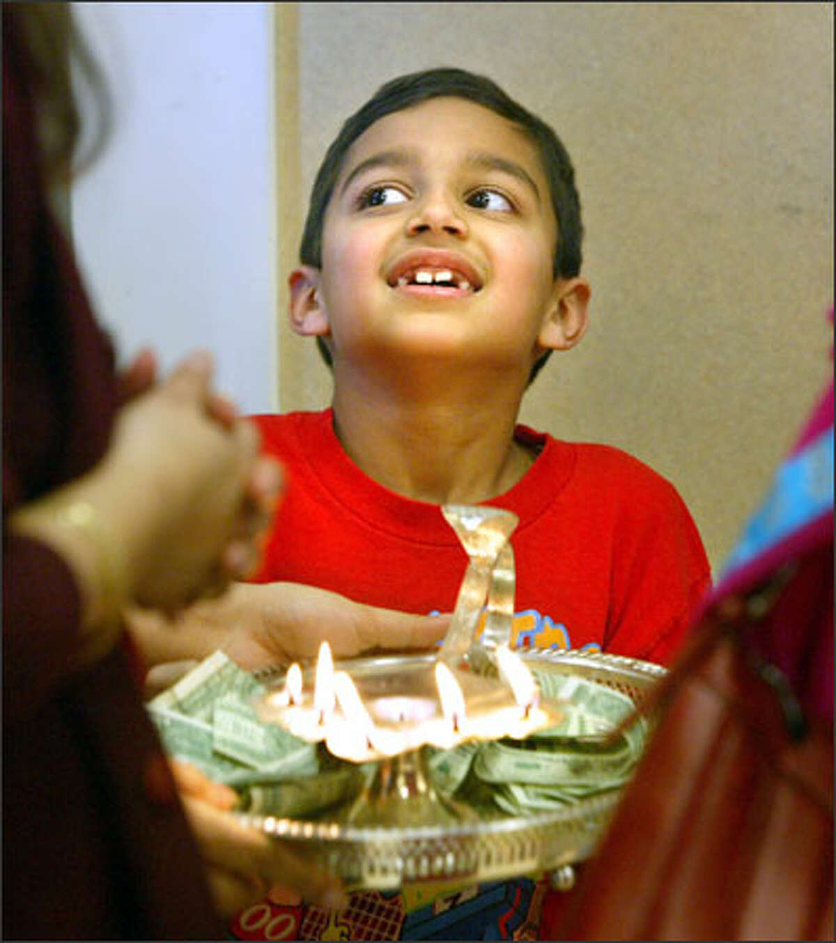 Kunal Sharma, 7, of Bothell holds a