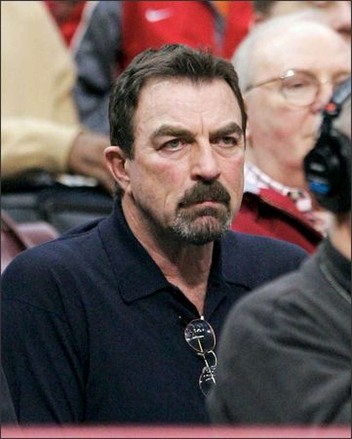 """The face of Tom Selleck registers his excitement during a recent college b-ball game in L.A. The ex-""""Magnum P.I."""" star sure knows how to have a fun time."""