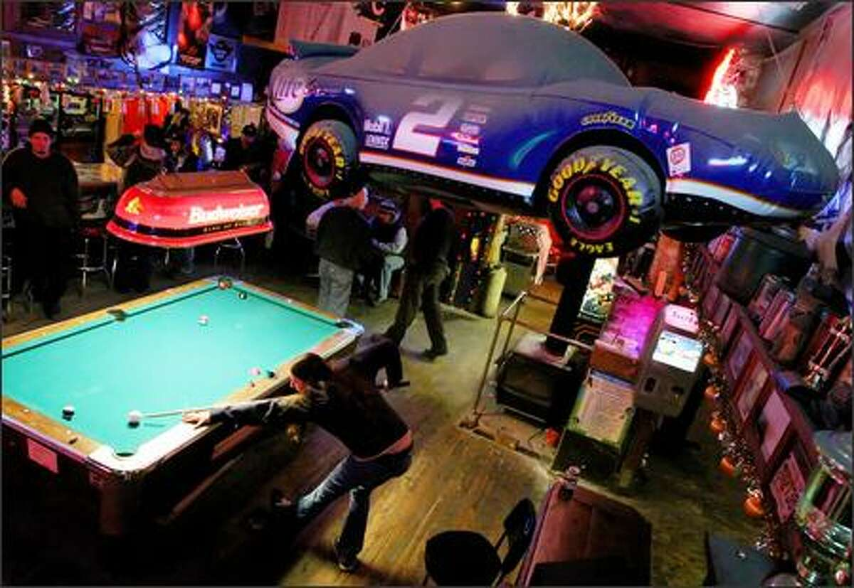 """Roni Brook works the pool table at Bethel Saloon in Port Orchard recently. The owner of the saloon, Dan Stewart, and many patrons support building a NASCAR track in Kitsap County. But state Sen. Margarita Prentice, D-Renton, sees no state need """"to invest in a white elephant."""""""