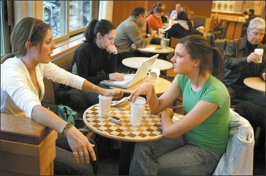"Kate Garberich, left, and Jane Corcoran, who visit a Starbucks almost every day, chat Tuesday at the Starbucks at University Village. ""I'm always hesitant to get stuff here because it's a little fatty,"" Corcoran said. ""It'll be a nice change."" Photo: Joshua Trujillo, Seattlepi.com / seattlepi.com"