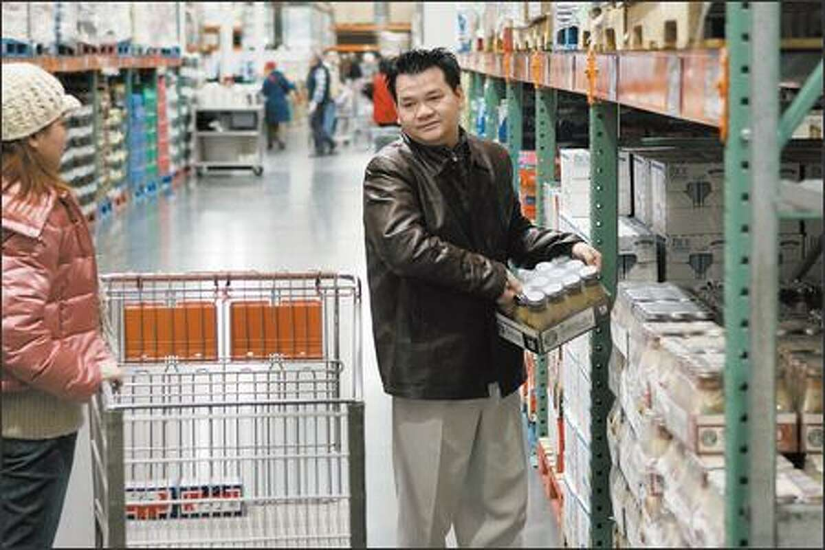 Andy Ta of White Center picks up a package of Starbucks Frappuccino drinks at Costco. Starbucks products account for about 90 percent of the ready-to-drink coffee market in the United States. Coca Cola and Caribou Coffee plan to introduce an iced coffee drink this year.