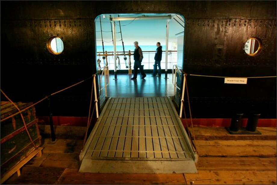 Visitors walk through an exhibit showing how Nordic Europeans immigrated to the U.S. In the early days, a voyage might take up to four months. By the 1860s it took 14 days. Photo: Joshua Trujillo, Seattlepi.com / seattlepi.com