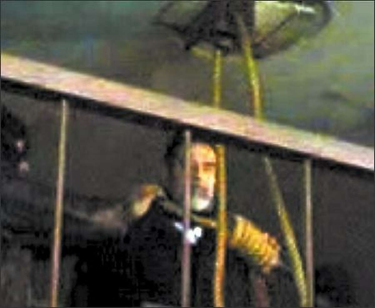 This image taken from an Arab-language Web site, and seemingly shot by a camera phone, shows former Iraqi leader Saddam Hussein moments before his hanging in Baghdad on Saturday.