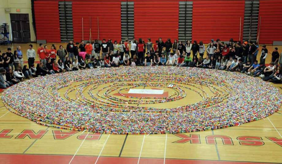 In celebration of Pi Day, Masuk High School students, with help from local preschoolers, made a paper chain using a different color for each of the ten digits of pi.  They are hoping to set a Guinness World Record for the length of their chain. Photo: Autumn Driscoll / Connecticut Post