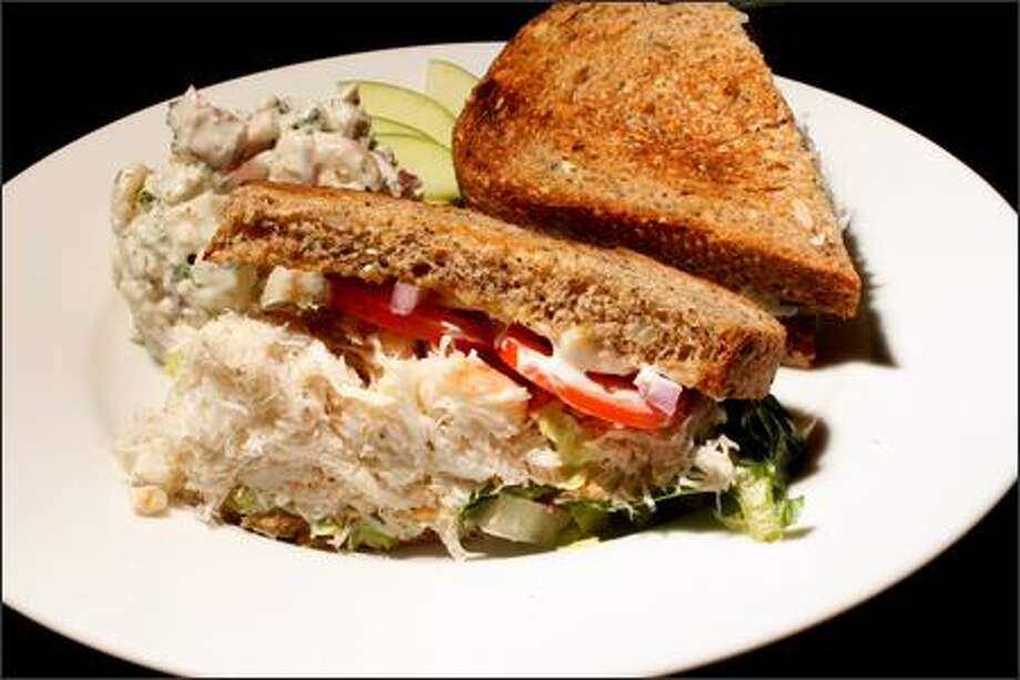 Bacco Cafe & Bistro's crab sandwich combines fresh crab meat and a little shredded lettuce, tomato and onion with a hint of mayonnaise, served here with blue cheese potato salad. Photo: Grant M. Haller, Seattle Post-Intelligencer / Seattle Post-Intelligencer