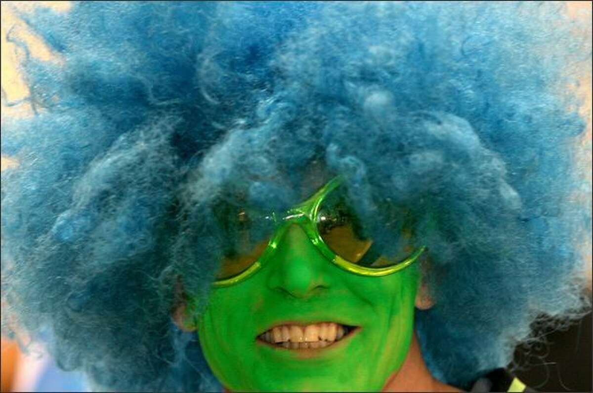 Maybe he should have gone for a mo-Hawk: Season ticket holder Greg Kockritz sports a blue wig and green face paint as he attends a Seahawks pep rally at Qwest Field on Friday.