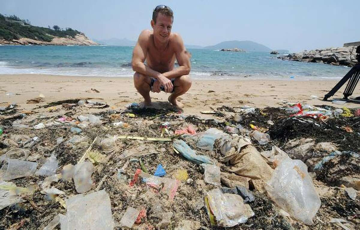 TO GO WITH Environment-US-Asia-ocean-waste-plastic,FEATURE by Guy Newey Doug Woodring, an entrepreneur and conservationist who lives in Hong Kong, looks at rubbish on May 07, 2009 on a beach on the south side of Hong Kong which has been left uncleaned. A group of conservationists and scientists is due to set sail for an obscure corner of the Pacific Ocean in the coming months to explore a vast swirl of waste known as the