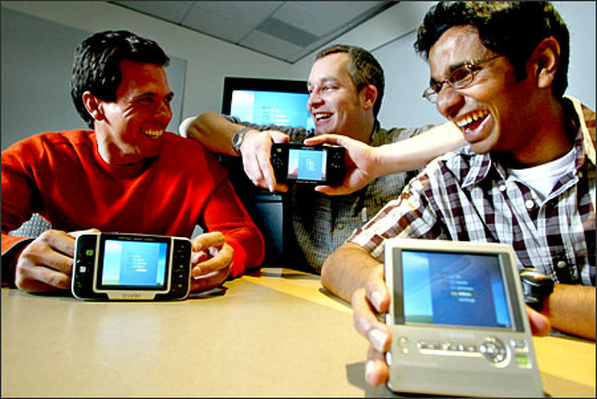 Microsoft's Portable Media Center was developed in the spare time of employees, from left, Marcus Ash, Brian King and Udiyan Padmanabhan.