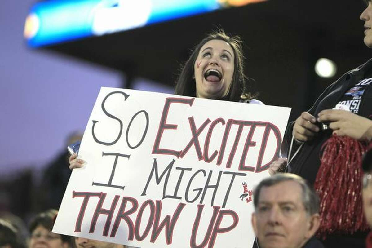 Eastern Washington graduate Melanie Duggan makes a face as she holds a sign before the FCS Championship NCAA college football game against Delaware, Friday, Jan. 7, 2011, in Frisco, Texas. (AP Photo/LM Otero)