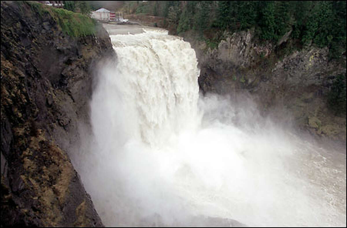 A high volume of water fueled by recent rains and runoff runs over Snoqualmie Falls on the Snoqualmie River in King County.