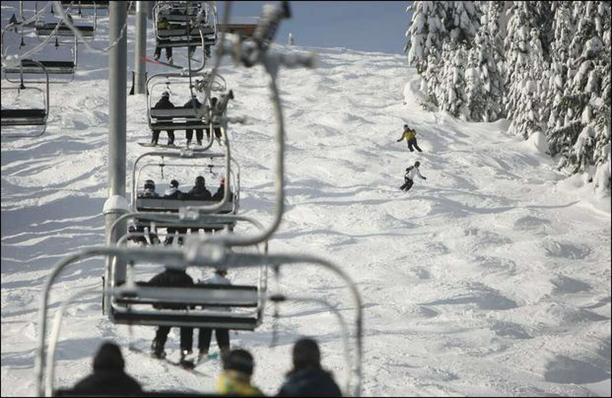 Skiers run the moguls on Wildcat, a black diamond run under the Silver Fir Express high-speed quad chairlift at the eastern end of Summit Central.