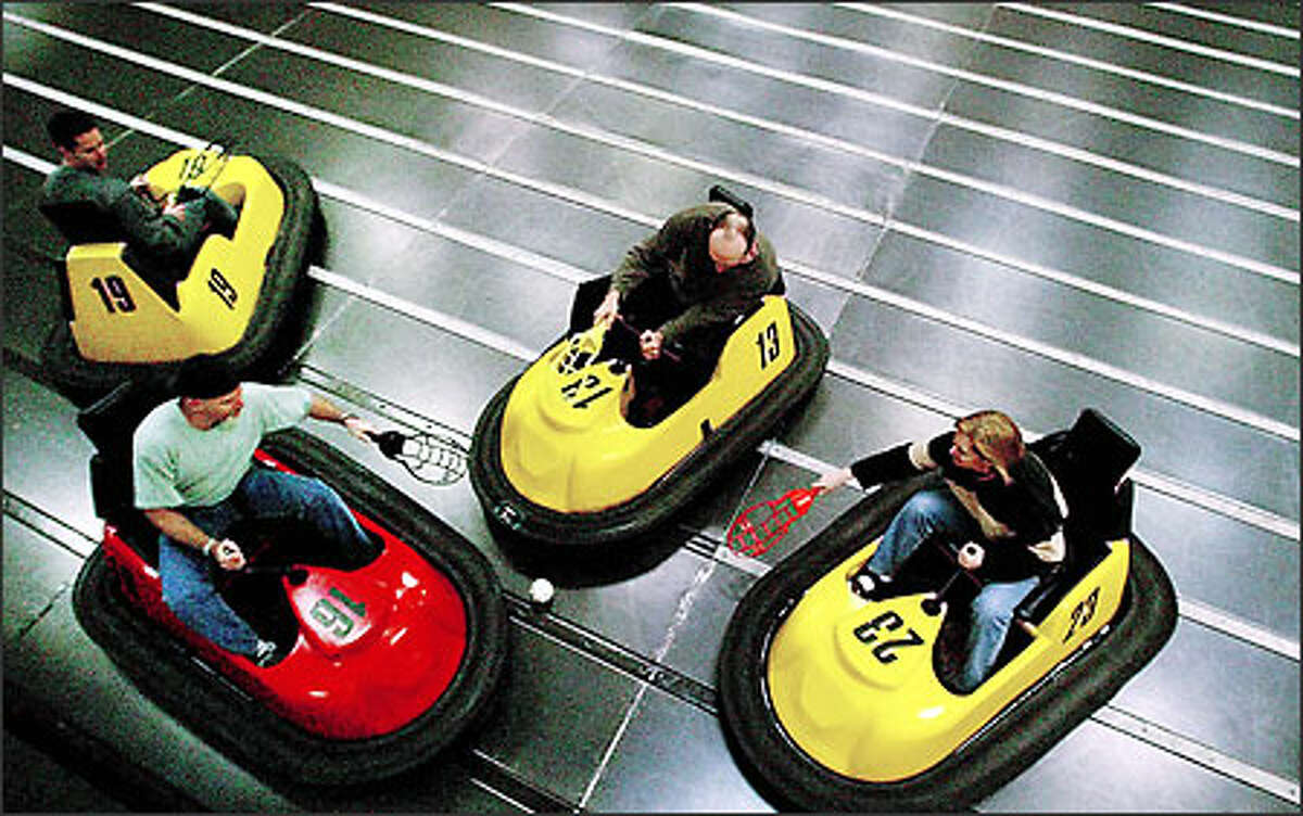 Players converge on the ball during a Microsoft employees WhirlyBall outing at an Edmonds center in December.