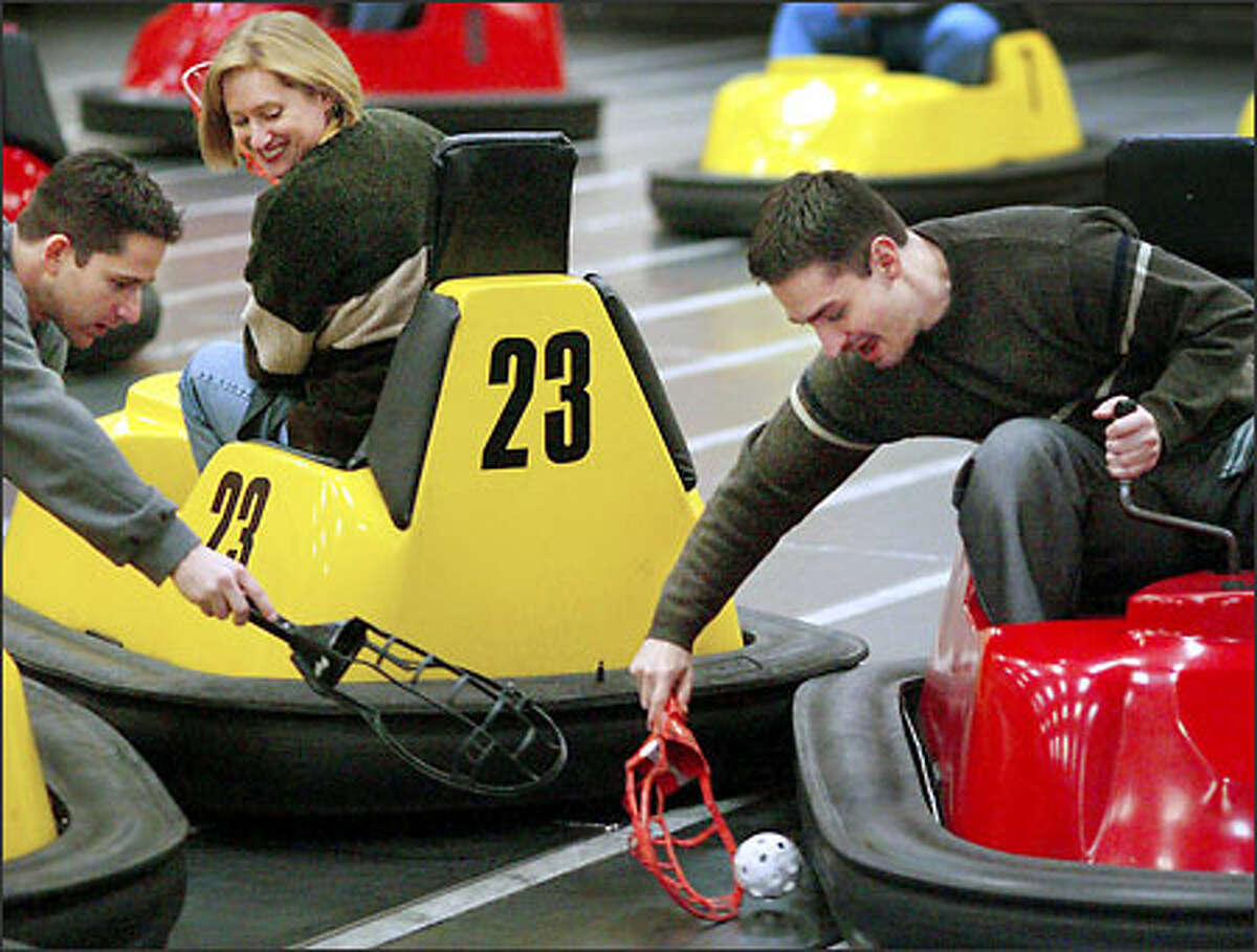 Alex Kipman scooped up the ball as opponents Gil Zalmanovitch and Donna Wallace defended. The game's founder calls WhirlyBall the