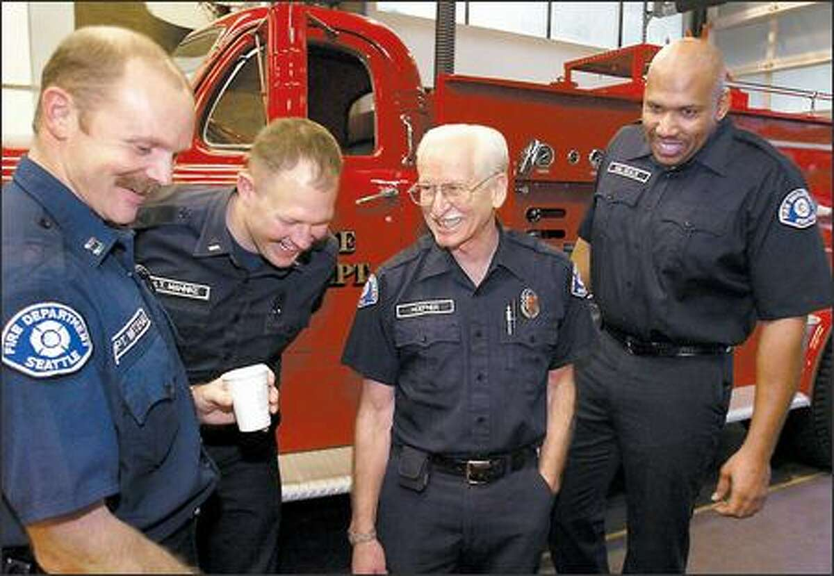Firefighter Ken Hoefner, 67, center, with Capt. Ken Whitehair, left, Lt. Jay Mahnke and Morlon Malveaux. The truck is the same kind Hoefner started out driving 45 years ago.