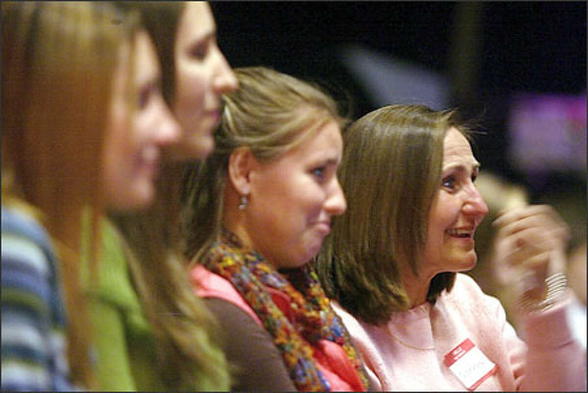 """Roseanne Dore, right, watches """"Extreme Makeover"""" with family members, from left, daughter Jessica Eddy, 22; niece Melissa Clinton, 18; and daughter Sarah Eddy, 18."""