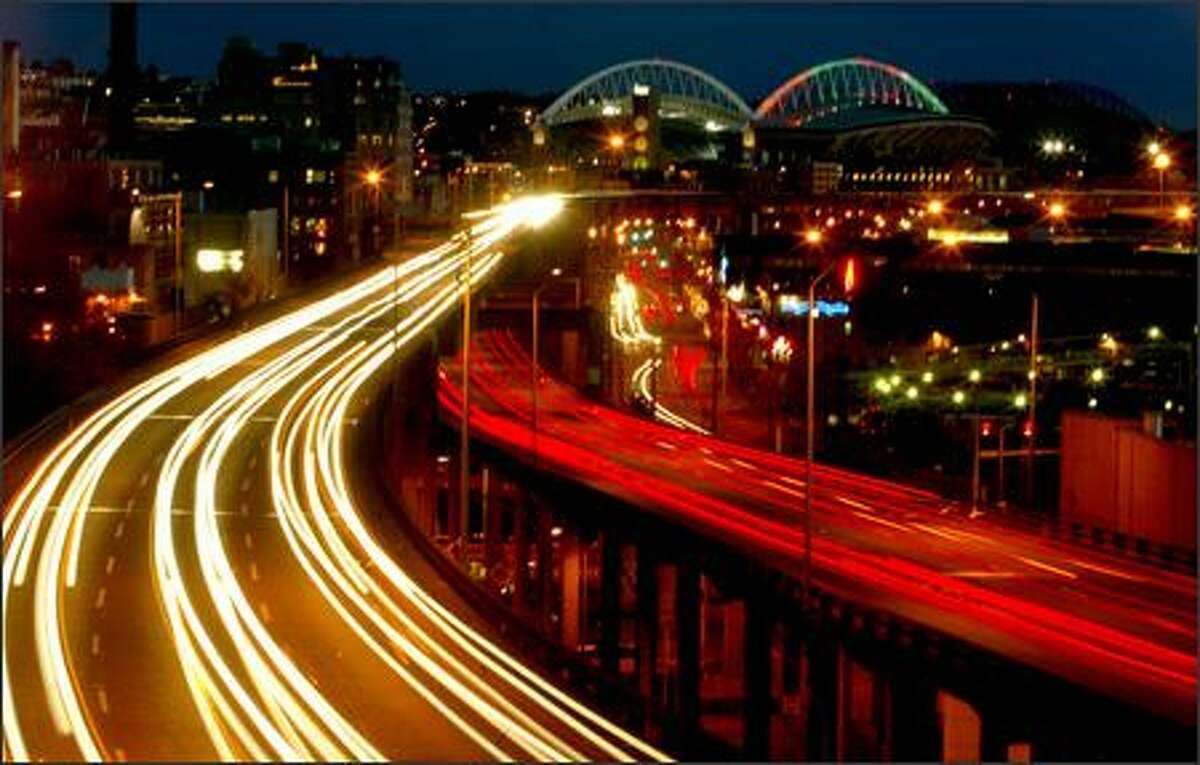 Traffic flows across the Alaskan Way Viaduct on the Seattle waterfront at dusk.
