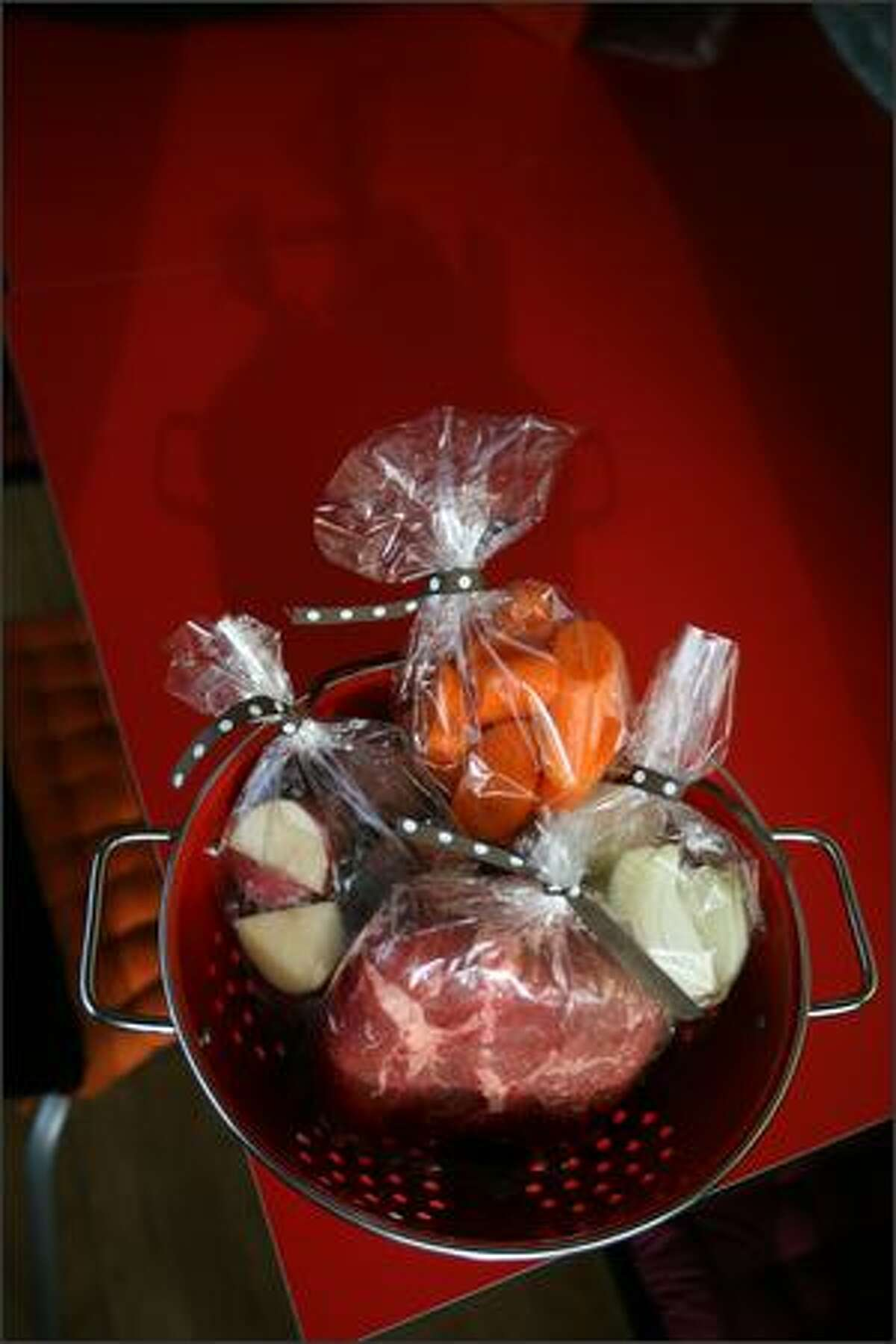 A welcome gift can be the ingredients for a slow cooker dish, such as these vegetables and meat for a pot roast.
