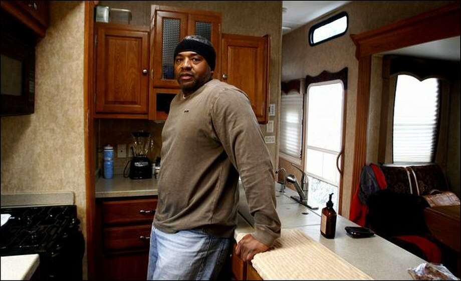 Antonio Britton, 39, an unemployed aerospace worker now living in his RV in a Wal-Mart parking lot, has been looking for a job since he was laid off from GE in November. Photo: Gilbert W. Arias, Seattle Post-Intelligencer / Seattle Post-Intelligencer