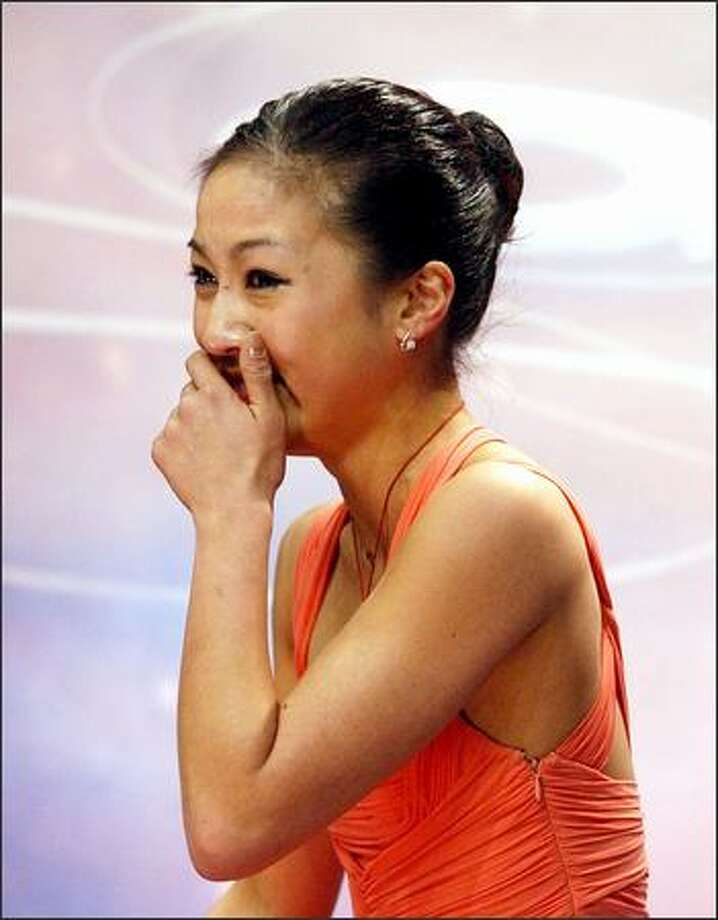 Michelle Kwan reacts as her scores are announced at the U.S. Figure Skating Championships in Atlanta. Kwan won the competition, her seventh straight and eighth overall. Only one of the sport's greats, Maribel Vinson, has more U.S. championships, with nine. Photo: Associated Press / Associated Press