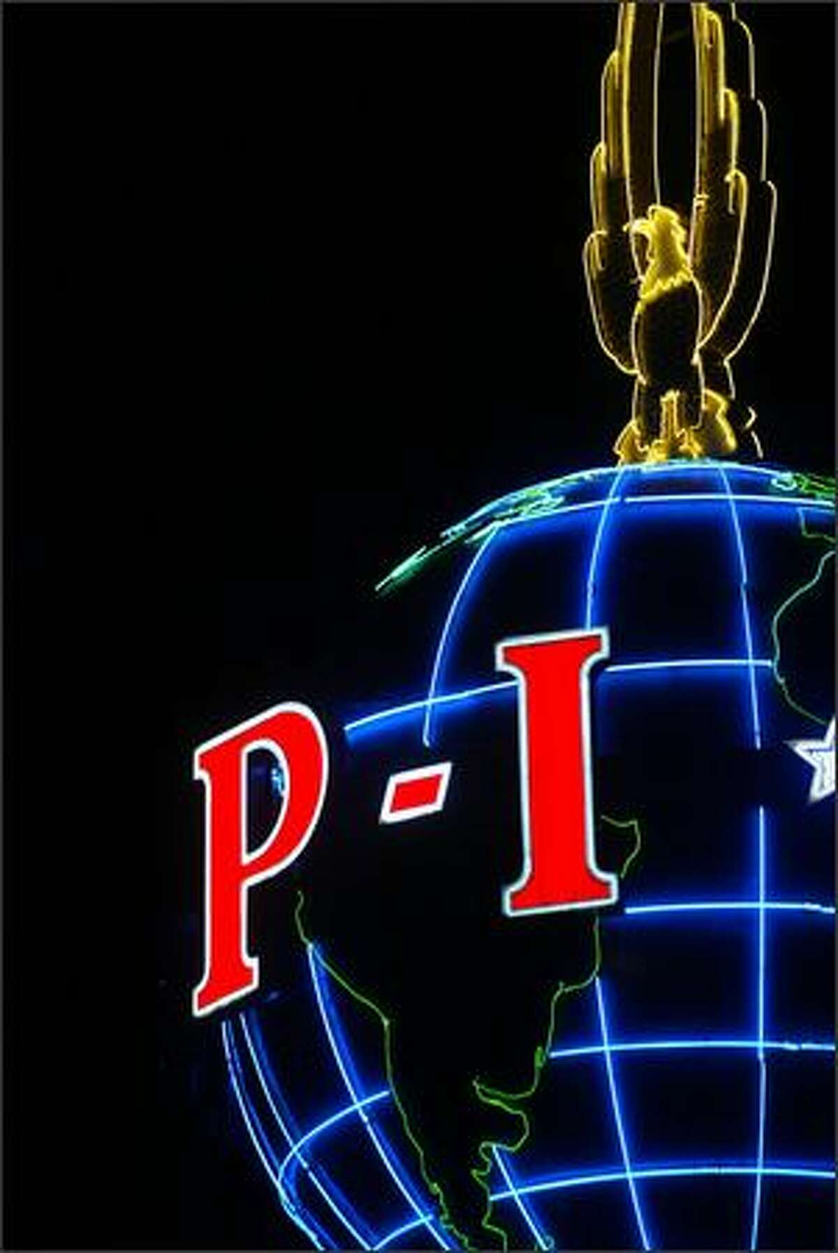 The Seattle P-I's neon globe has been a local landmark for over 60 years.