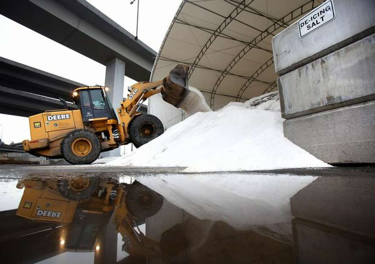 A front end loader prepares to load trucks with road salt during preparations for possible snowfall on Tuesday at the Charles Street facility south of downtown Seattle. SDOT was prepping for the possibility of a rush-hour snowfall.