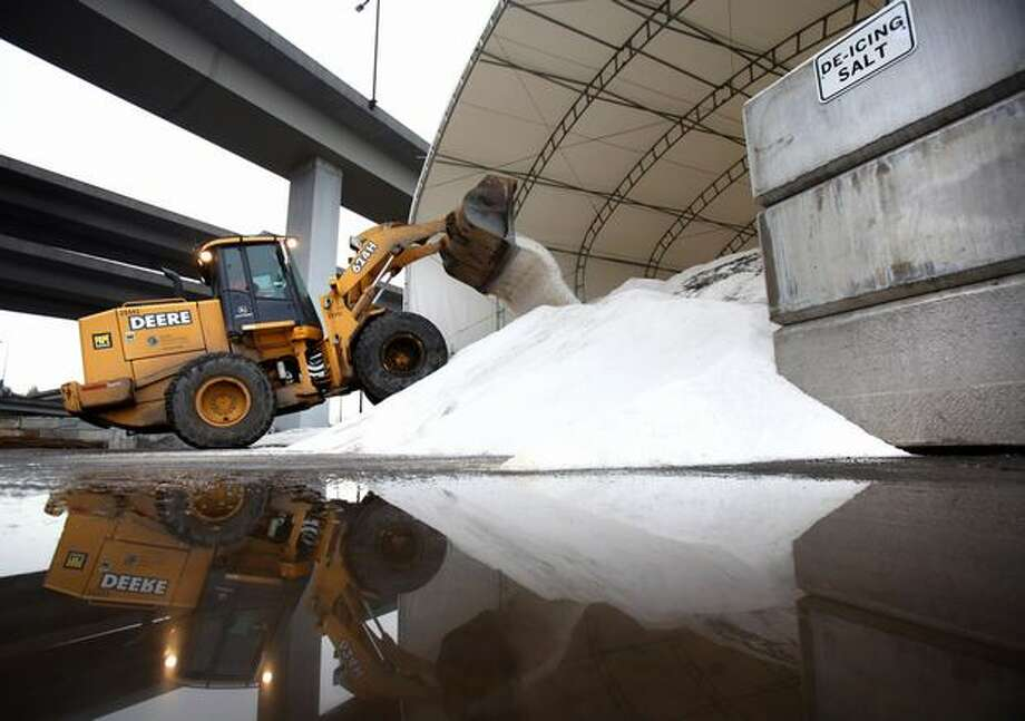 A front end loader prepares to load trucks with road salt during preparations for possible snowfall on Tuesday at the Charles Street facility south of downtown Seattle. SDOT was prepping for the possibility of a rush-hour snowfall. Photo: Joshua Trujillo, Seattlepi.com / seattlepi.com