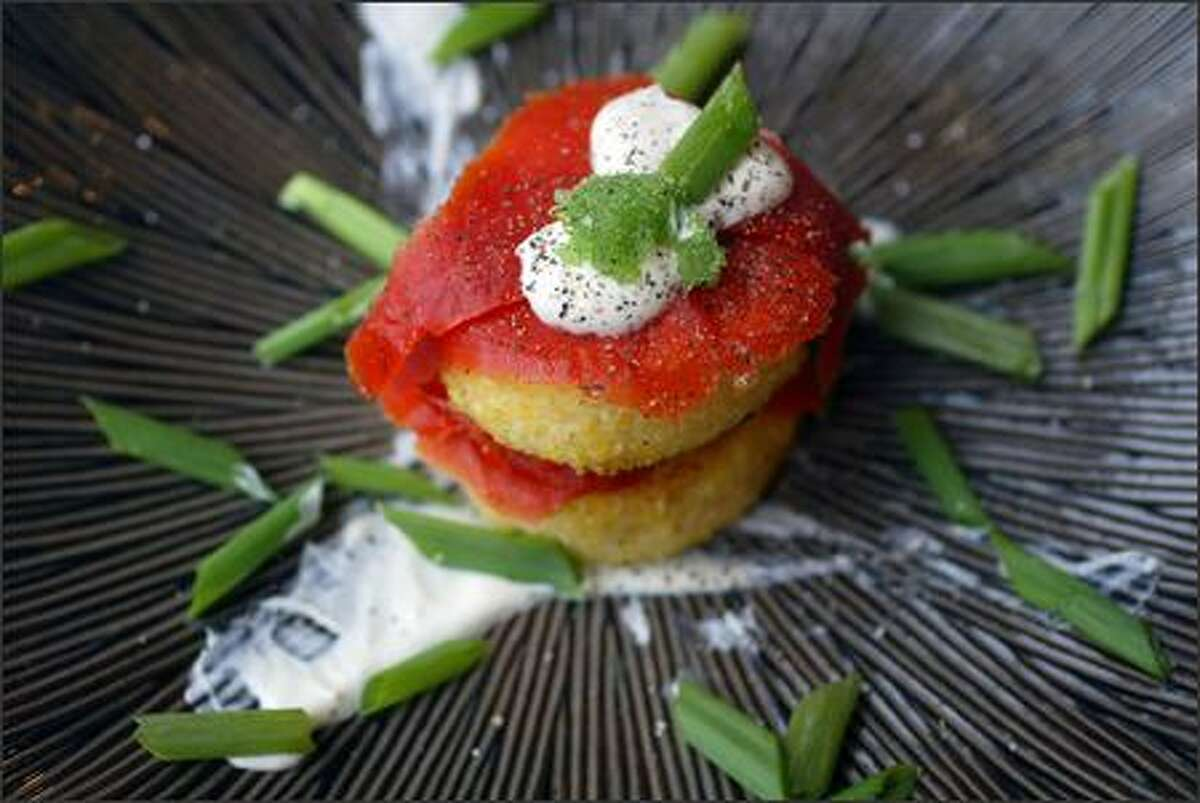 Baked polenta with house-cured salmon has a creme fraiche and green onion garnish. A lunchtime meal here is refreshingly filling.