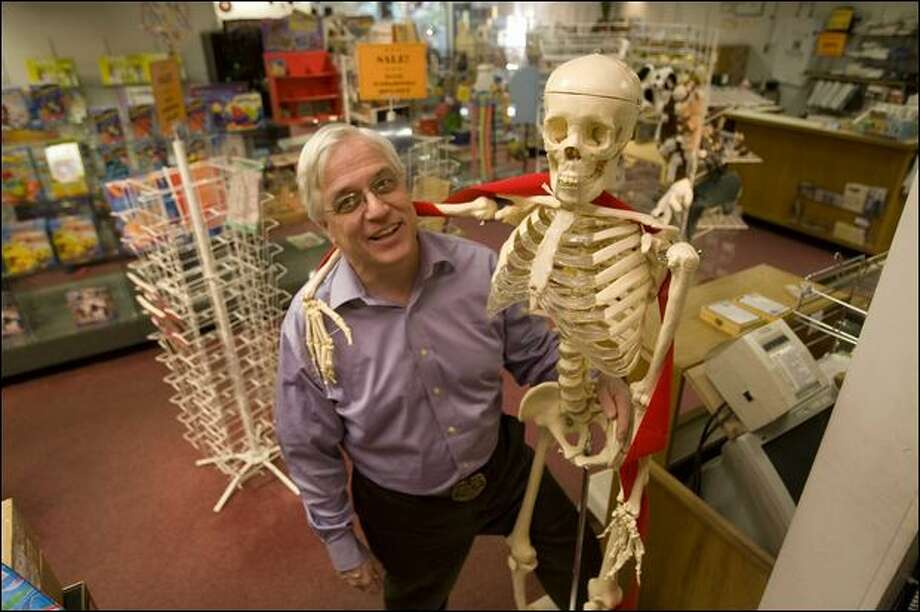 "Christmas season is ""supposed to take us through any of the lean months,"" says Science, Art and More owner Doug Livingston, of the store he's closing after 12 years. Photo: Grant M. Haller, Seattle Post-Intelligencer / Seattle Post-Intelligencer"