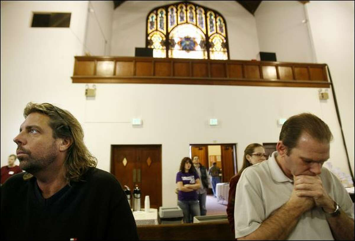 Michael Campbell, left, and Charles Capizano pray during a service at Capitol Hill Presbyterian Church.