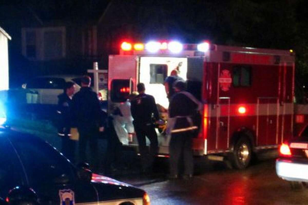 One of two shooting victims in a Monday night home-invasion robbery is placed into Medic 31 in the 1400 block of North Northgate Way.