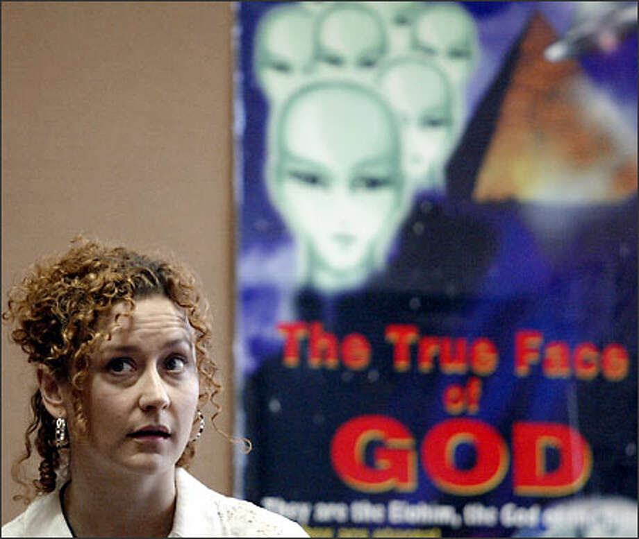 "Karen Heaven, ""the lone Raelian"" of Washington state, listens as Denise Belisle, a Canadian member, speaks about human cloning at University Heights Center. Photo: Jim Bryant, Seattle Post-Intelligencer / Seattle Post-Intelligencer"