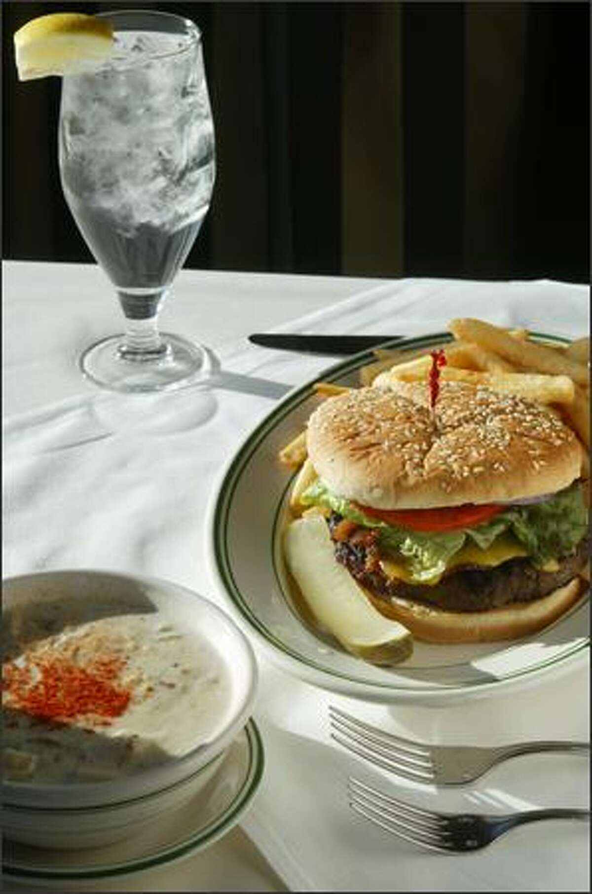 An Angus burger with bacon and cheese and a bowl of clam chowder from the Pier 70 Cafe.