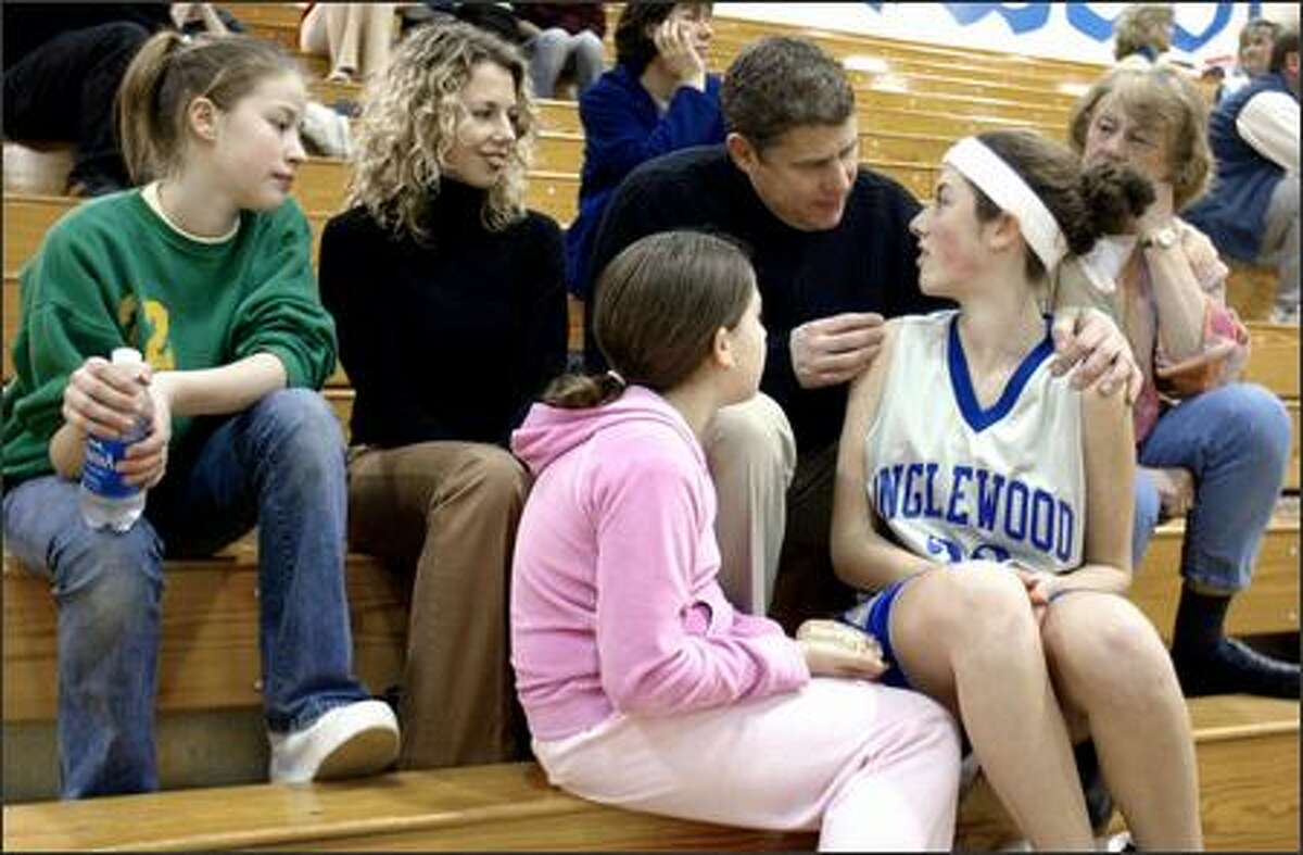 John Greig, agent and entrepreneur, gives daughter Cristina some encouragement before a middle school game. With Greig are wife Kirsten, daughters Alysha, left, and Noelle, and mother Betty Foose, right.