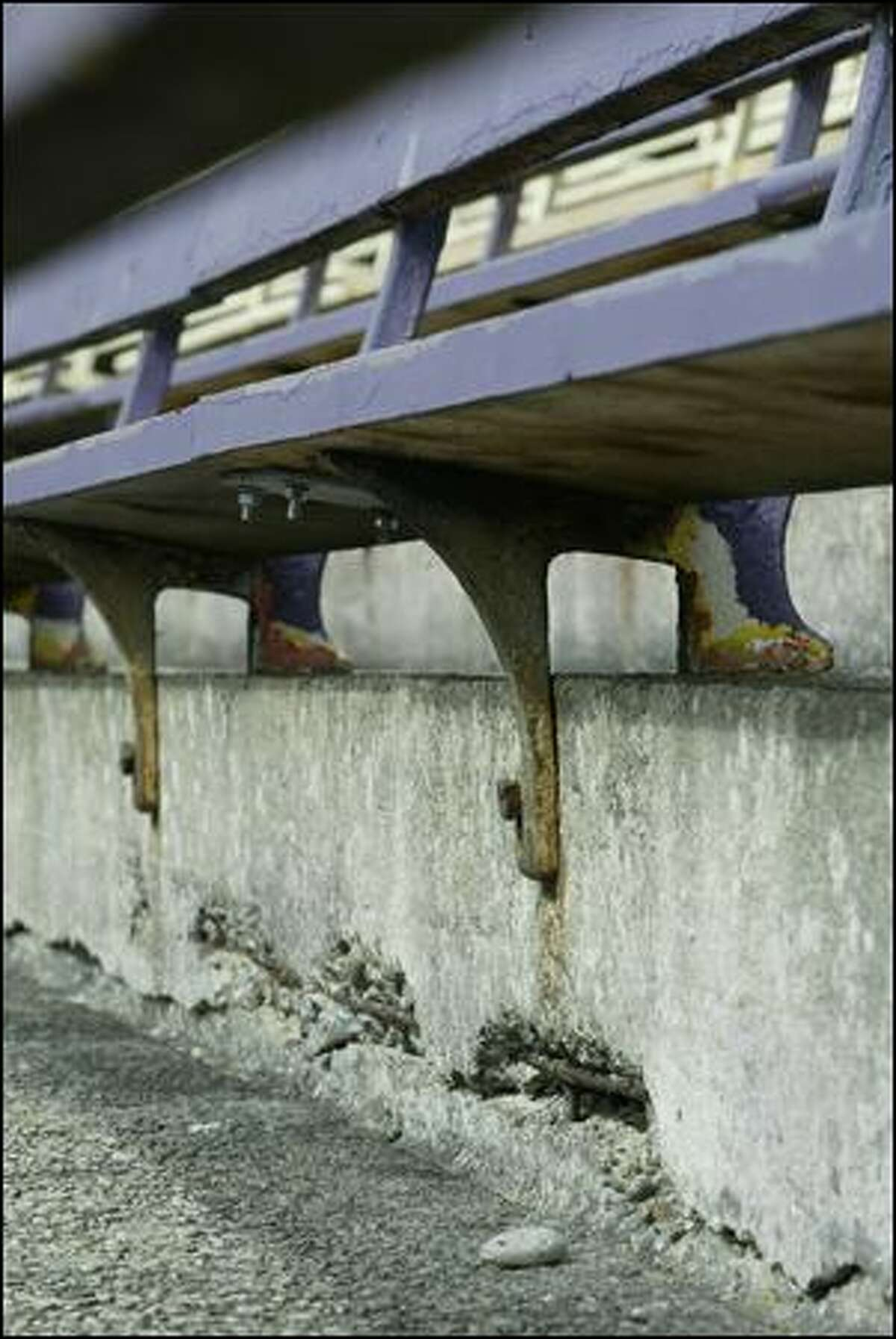 Lateral cracks in the concrete that makes up the lower bowl of Husky Stadium can be seen beneath the bleachers. (P-i File / 2007)