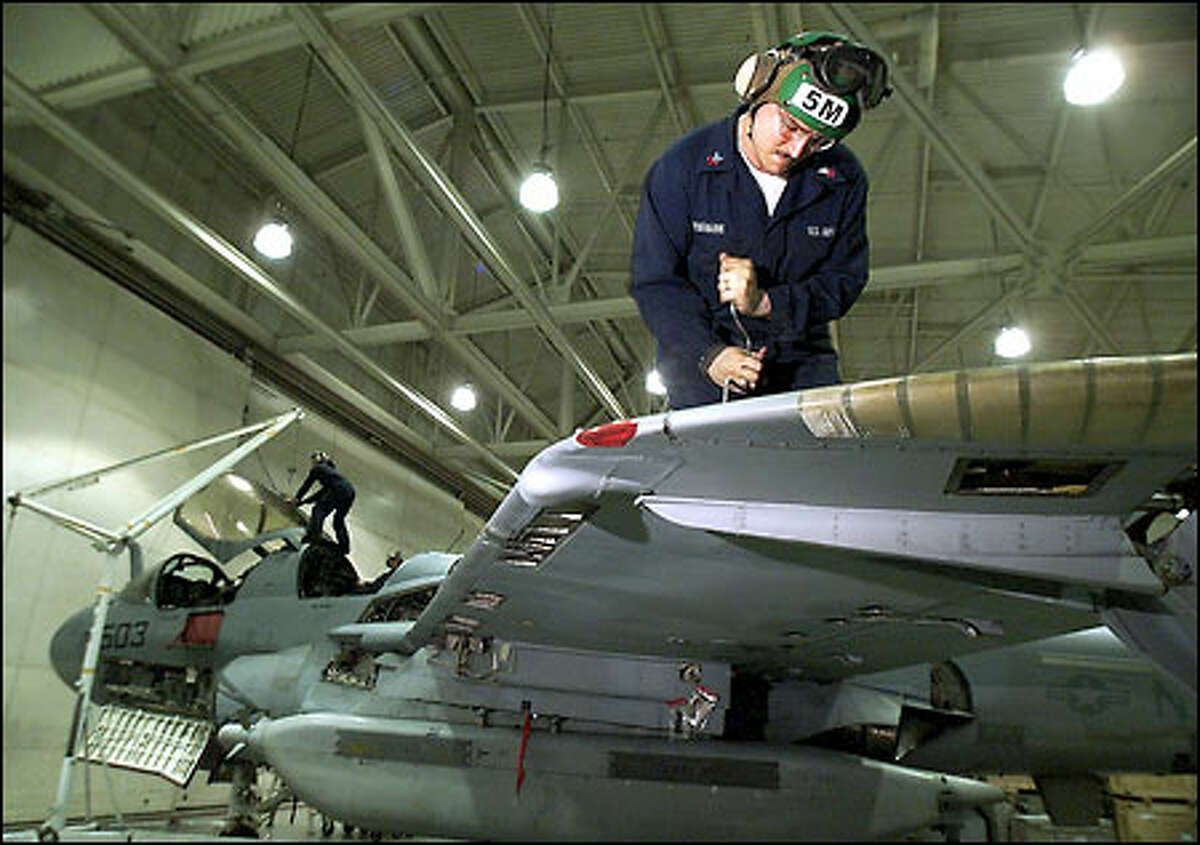 Petty Officer Robert Tiedemann, a structural mechanic, at work on a Prowler at Whidbey.