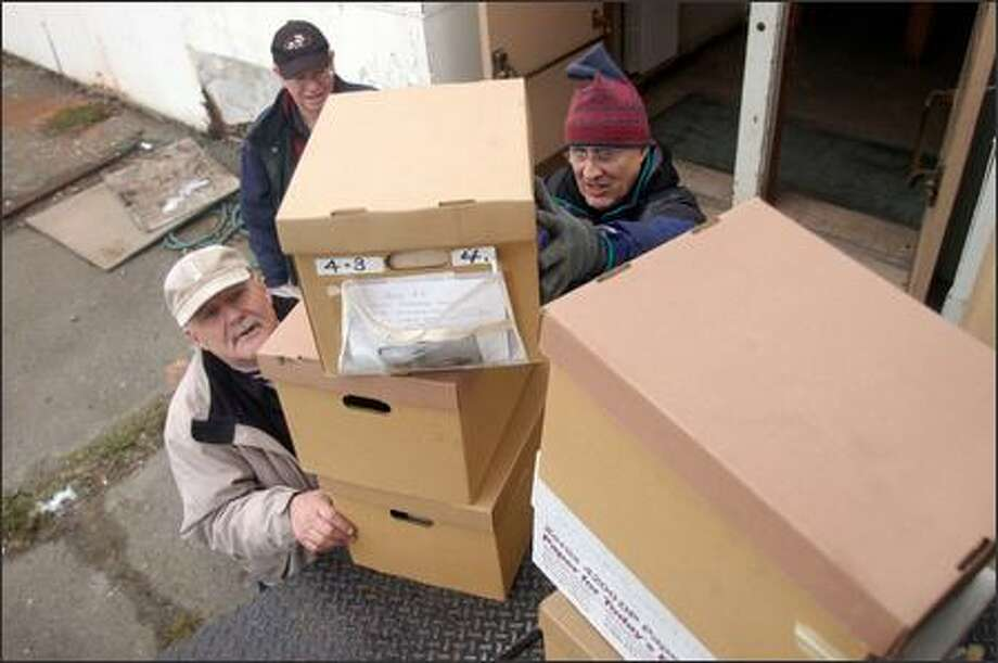 Volunteers, from left, Michael Hansen, Bill Milne and Gary Long help move Highline Historical Society's museum collection to Seattle Christian School's old building. Photo: Julie Graber, Special To The Seattle Post-Intelligencer / Special to the Seattle Post-Intelligencer