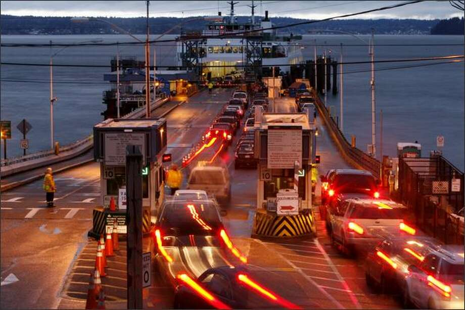 Vehicles start to fill up the Fauntleroy dock as the ferry Issaquah leaves with a load of cars for Vashon Island and Southworth late Monday afternoon. Photo: Grant M. Haller, Seattle Post-Intelligencer / Seattle Post-Intelligencer