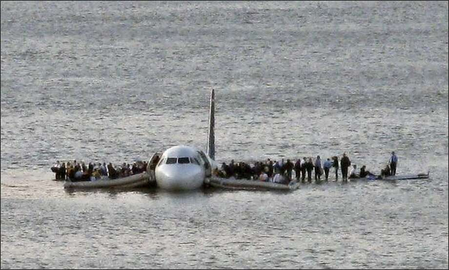 "Capt. Chesley ""Sully"" Sullenberger landed the crippled jet on the Hudson River and made sure all 154 of the other people aboard got off before he left. All survived. Photo: Associated Press / Associated Press"