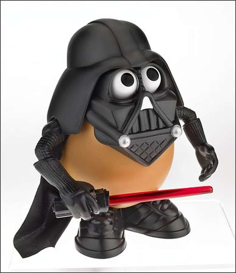 "Coming in February from Hasbro Inc.'s Playskool division: ""Darth Tater,"" a special Mr. Potato Head dressed as ""Star Wars"" villain Darth Vader. The doll will retail for approximately $7.99 and is recommended for ages 2 and up. Photo: Associated Press / Associated Press"