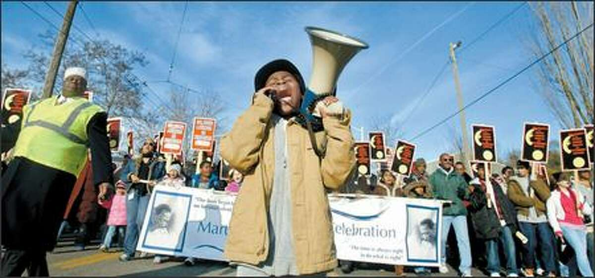 Isaiah Barnett, an 8-year-old third-grader at The Bush School, leads the annual Martin Luther King Jr. Day march from a rally at Franklin High School to a second rally at Martin Luther King Jr. Memorial Park.