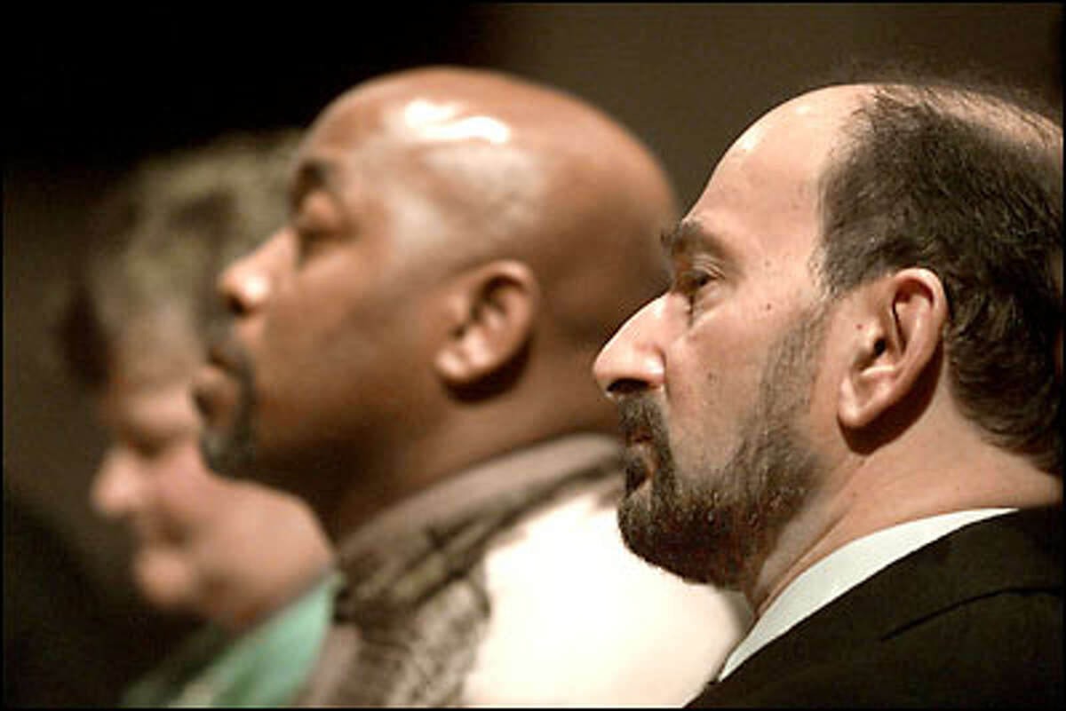 Yousif Farjo, an Iraqi American who was a speaker at the event, listens during an interfaith remebrance entitled The Gulf War: Ten Years Later held at the University Temple Methodist Church. On left is Alvin Clark, a Gulf War veteran who also spoke at the event.