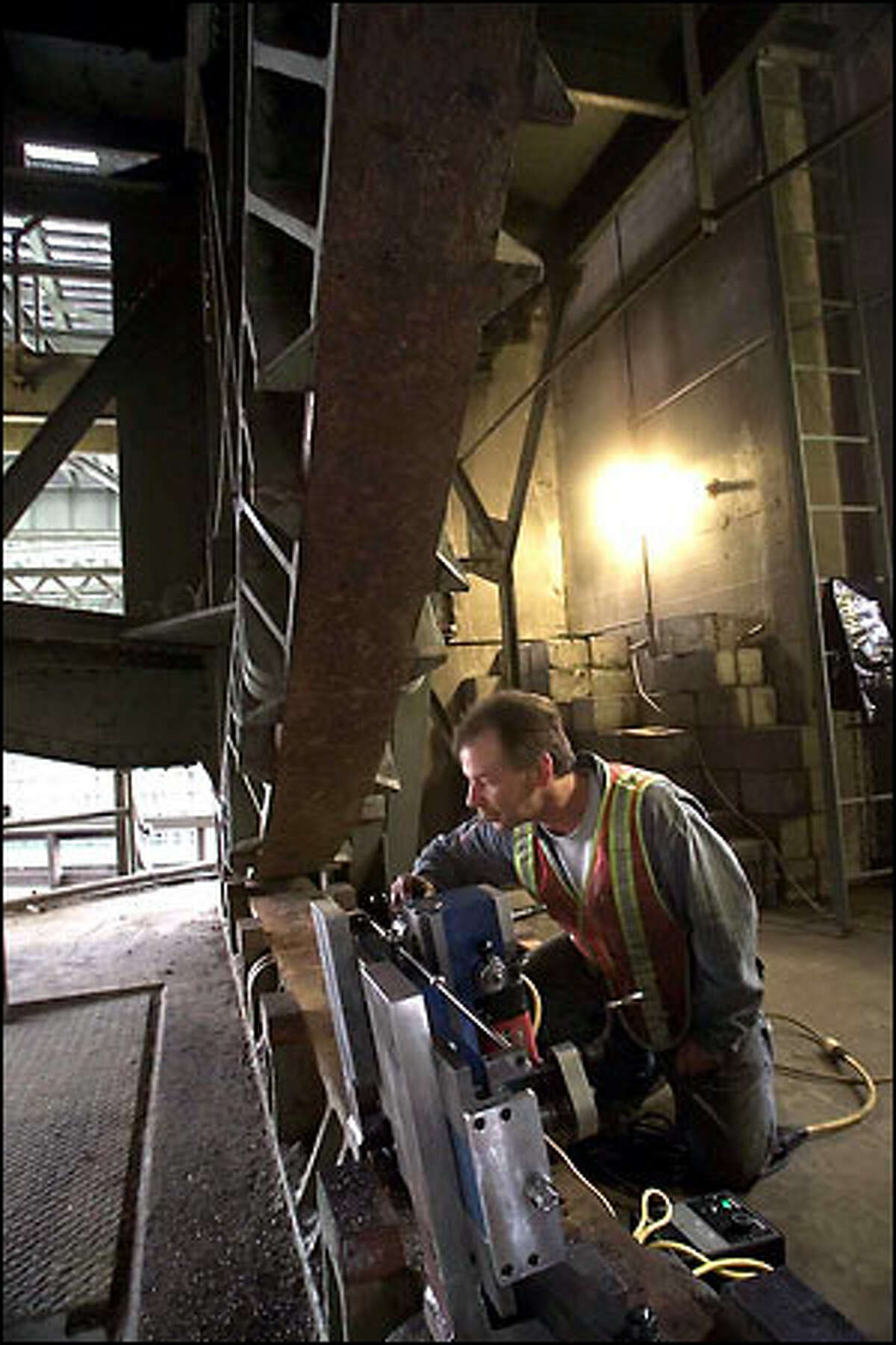 Machinist Justin Killingbeck mills lugs to help realign the drawspan section of the South Park Bridge.