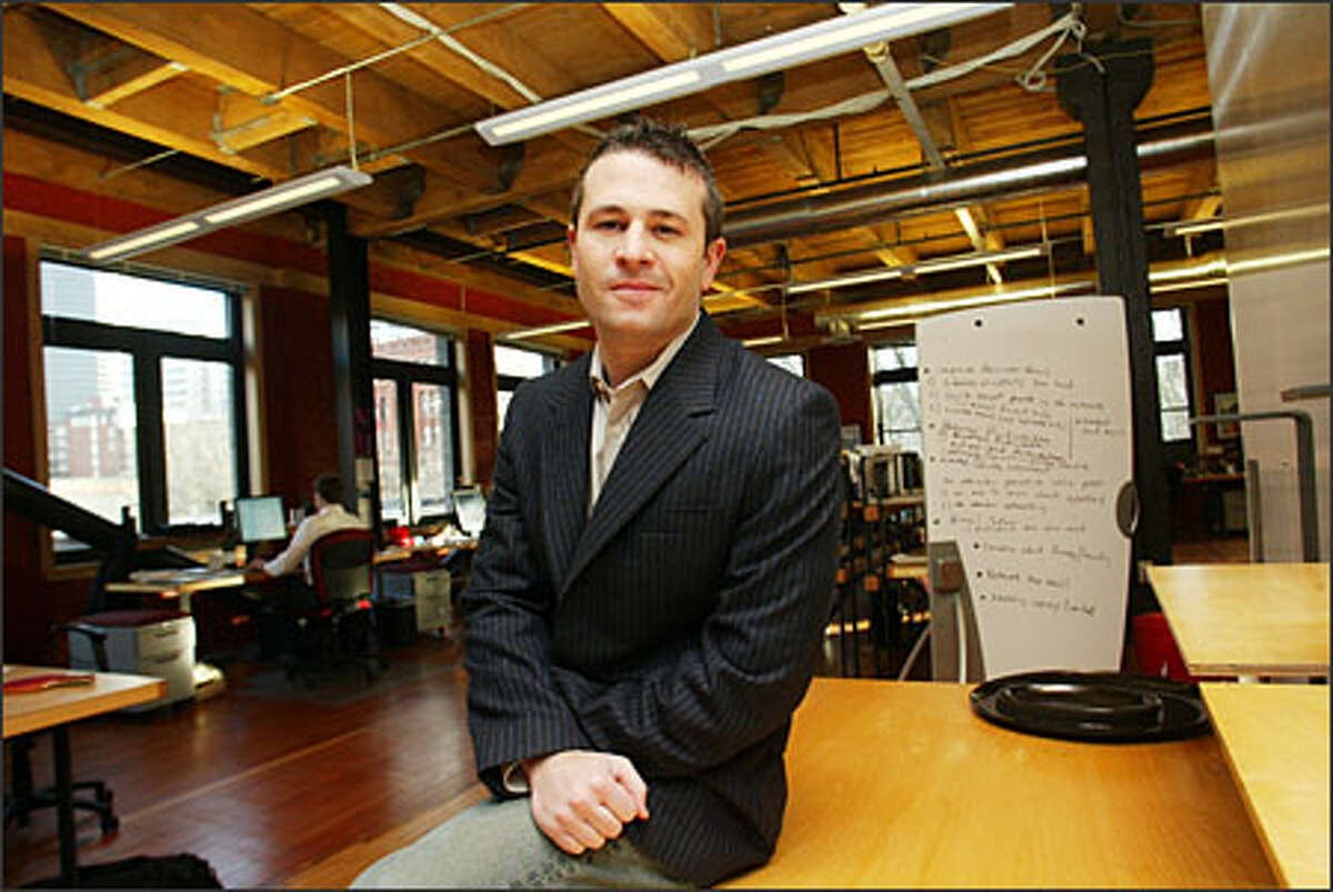 Jason Goldberg, chief Jobster, in his Pioneer Square offices. His company is taking a different look at the way people are recruited for jobs.