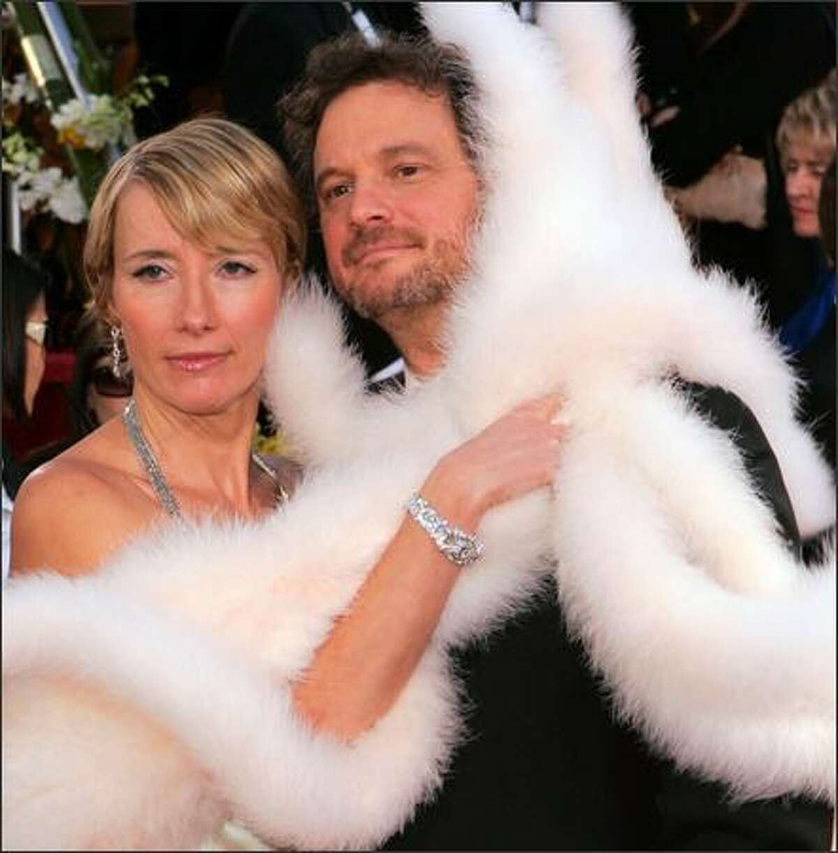 Brits Emma Thompson and Colin Firth model the latest in formal Hollywood attire -- faux fur for two! This dashing little white number, modeled at the Golden Globes festivities, caused a commotion among other celebrants, who instantly sensed that the days of ol' faux fur for one may well be kaputski.