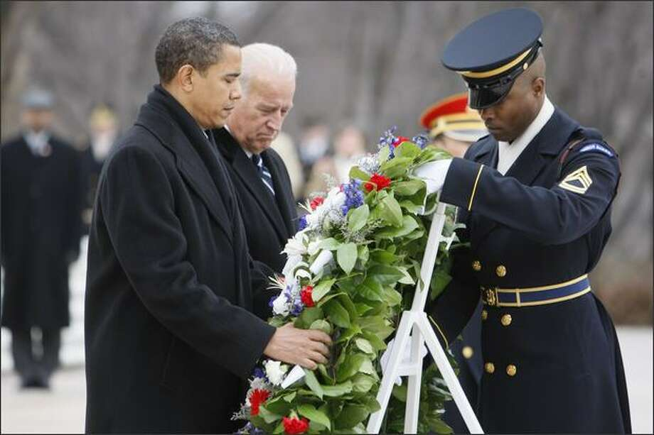 President-elect Barack Obama and Vice President-elect Joe Biden lay a wreath at the Tomb of the Unknowns at Arlington National Cemetery in Arlington, Va., on Sunday. Photo: Associated Press / Associated Press