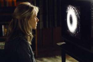 "Investigative reporter Rachel Keller (Naomi Watts) tracks down and watches a videotape that is rumored to doom anyone who sees it to death in seven days in DreamWorks Pictures' horror thriller ""The Ring."" (AP Photo/Merrick Morton)"