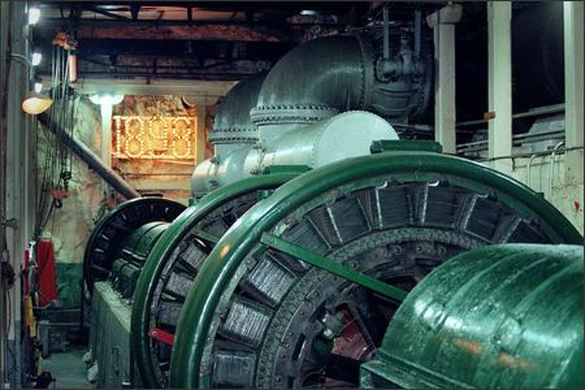 The turbine room of Puget Sound Energy's Snoqualmie Falls power generation plant is located deep under the falls. The turbines pictured are original machinery.