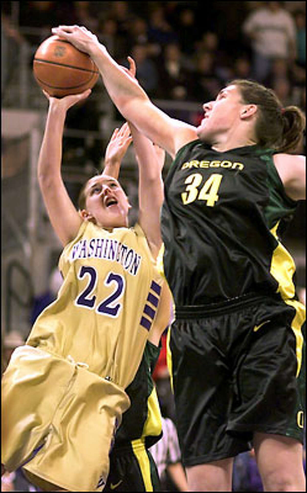 Forward Loree Payne, who led the Huskies with 14 points, has her shot blocked by Oregon center Jenny Mowe.