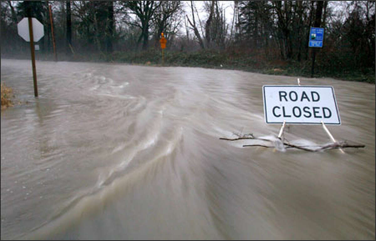 Southeast Mill Pond Road near Southeast Reinig Road in Snoqualmie was a virtual river yesterday as the Snoqualmie River flooded after a record rainfall. More flooding is predicted.